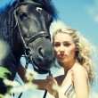 Beauty with horse — Stock Photo