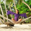 Woman in hammock on beach - Foto de Stock