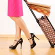 Woman with travel suitcase — Stock Photo #5387096