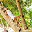 Woman on palm tree — Stock Photo