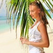 Woman near palm tree — Stock Photo #5441570