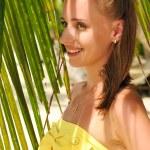Woman near palm tree — Stock Photo