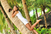 Woman on palm tree — Stock Photo