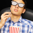 Young man at cinema — Stock Photo #5537459