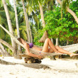Woman in hammock on beach - Foto Stock
