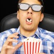 Young man at cinema — Stock Photo