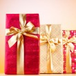 Celebration concept - Gift box against colorful background - Стоковая фотография