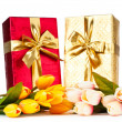 Celebration concept - gift box and tulip flowers - Стоковая фотография