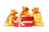 Gift boxes and golden sacks — Stock fotografie