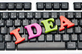 Ideas concept with letters on the keyboard — Stock Photo