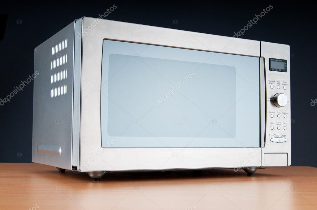 Microwave oven on the table — Stock Photo #5549105