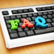 Stock Photo: FAQ concept with letters on keyboard