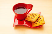 Cup of tea and fresh cookies on table — Stockfoto