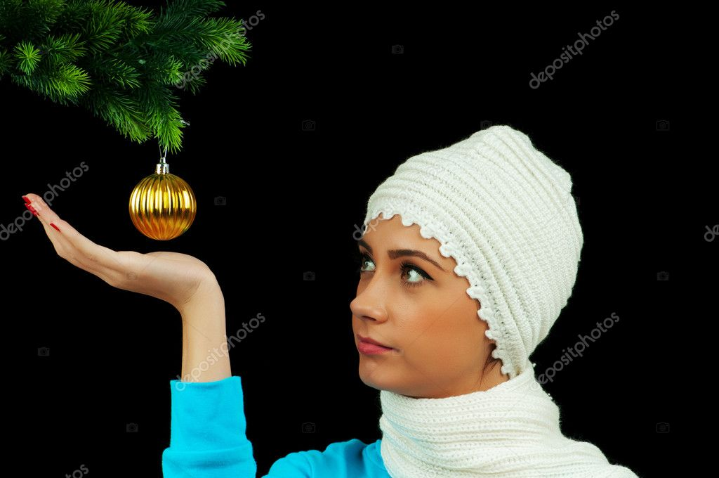 Young girl decorating christmas tree isolated on black  Stock Photo #5553688