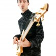 Guitar player isolated on the white background — Stock Photo #5561311
