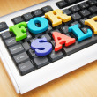 SALE word on the keyboard — Stockfoto