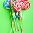 Stock Photo: Colorful lollipop against background