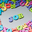 Stock Photo: Employment concept with letters on background