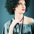 Young attractive girl with afro curly haircut — Stock Photo #5593473