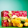 Celebration concept - gift box and tulip flowers — Stock Photo #5594629