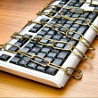 Computer security concept with keyboard and chain — Stock Photo