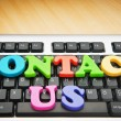 Contact us concept with letters on keyboard — Stock Photo