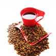 Cup of coffee with many beans around - Stock Photo