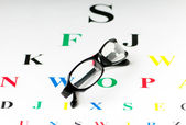 Optical reading glasses on the eyesight table — Stockfoto