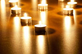 Many burning candles with shallow depth of field — Photo
