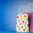 Shopping bags against gradient background - Foto Stock