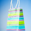 Shopping bags against gradient background - Photo