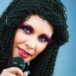 Pop star singing the song at concert — Stock Photo #5605564