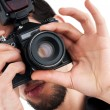 Stock Photo: Photographer with the digital camera