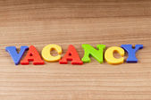 Employment concept with letters on background — Stock Photo