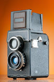 Vintage film camera against gradient background — Stock Photo