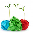 Paper recycling concept with seedlings on white — Stock Photo #5704521