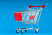 Shopping cart against the background — Stok fotoğraf