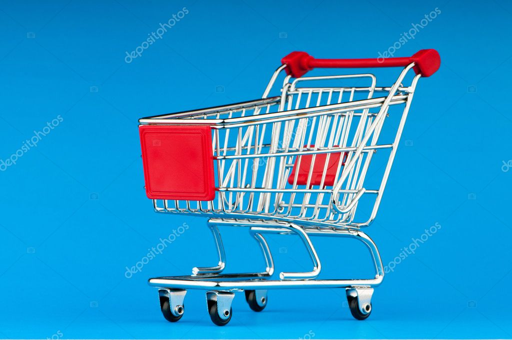 Shopping cart against the background — Stock Photo #5704456