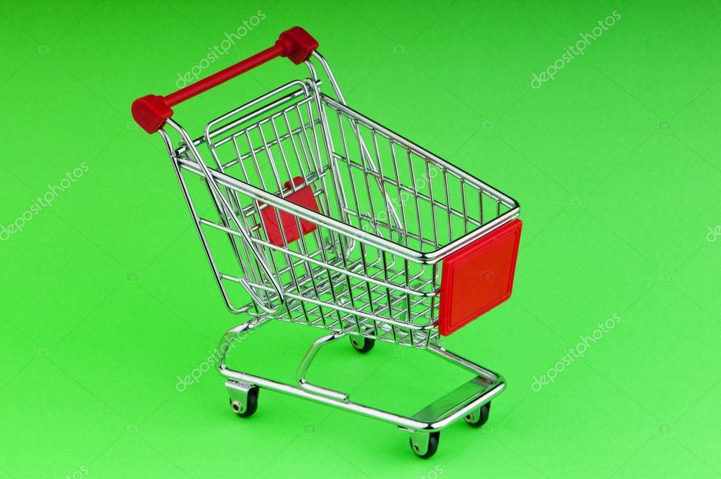 Shopping cart against the background — Stock Photo #5704463