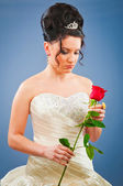 Beautiful bride with rose in studio shooting — Stockfoto