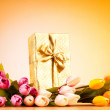 Celebration concept - gift box and tulip flowers — Stock Photo
