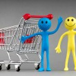 Happy family with shopping cart — Stock Photo #5873567