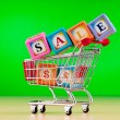 Stock Photo: Shopping cart against the background