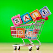 Shopping cart against the background — Stock Photo #5876402