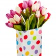 Tulips in the bag isolated on white — Stock Photo