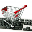 Internet online shopping concept with computer and cart — Foto Stock
