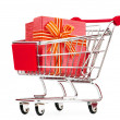 Shopping cart and giftboxes on white — Stock Photo