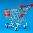 Shopping cart against the background - Stok fotoğraf