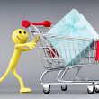 Smileys with gift box in the shopping cart - Stok fotoğraf