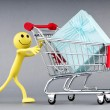 Smileys with gift box in the shopping cart - Foto Stock